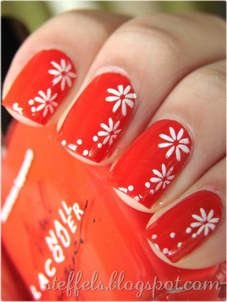 Orange nails and white flowers