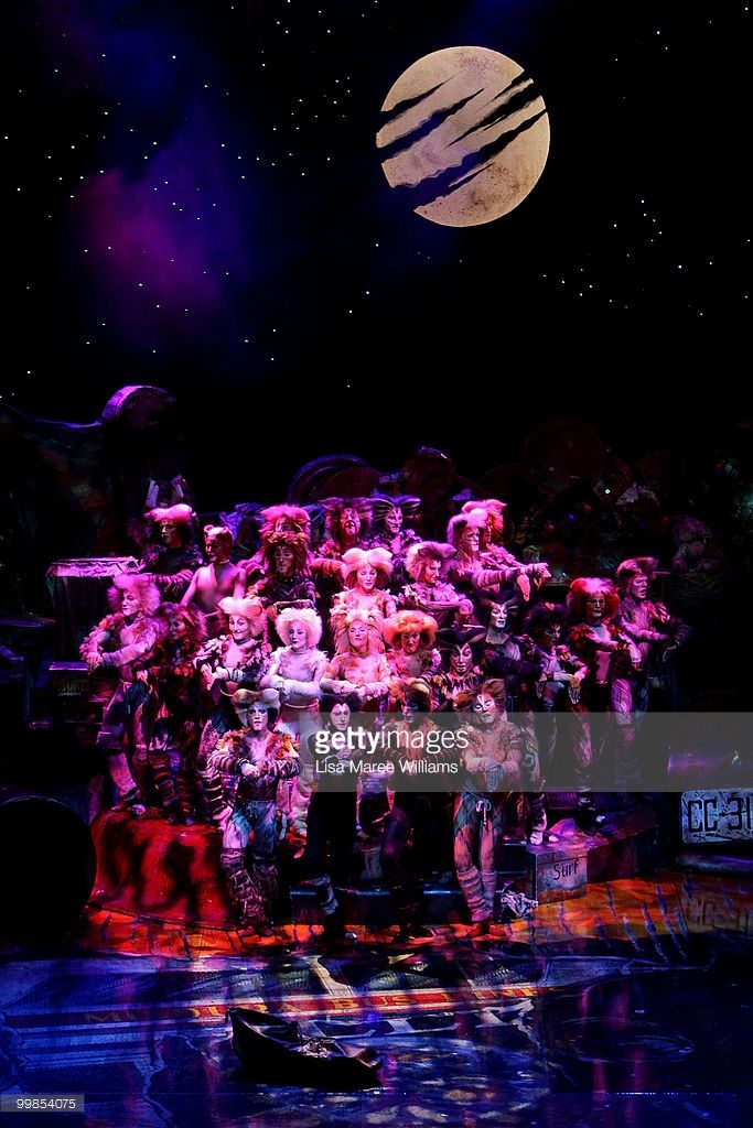 Cast members perform on stage during a media preview for