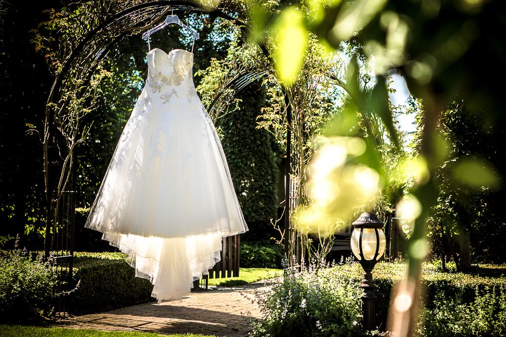 Love this shot of a hanging wedding dress in the garden.