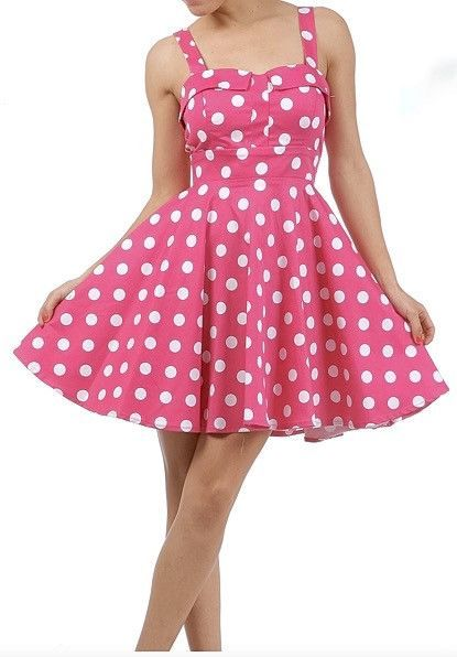 cc705977130 This full skirted pinup style polka dot dress features a fitted waist line
