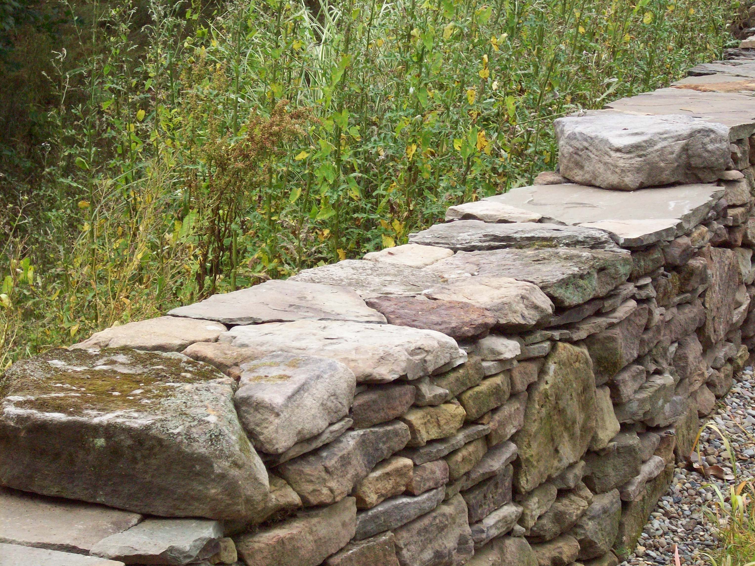 Dry Stack Fieldstone Retaining Wall : Dry stack rock wall for the front circle garden