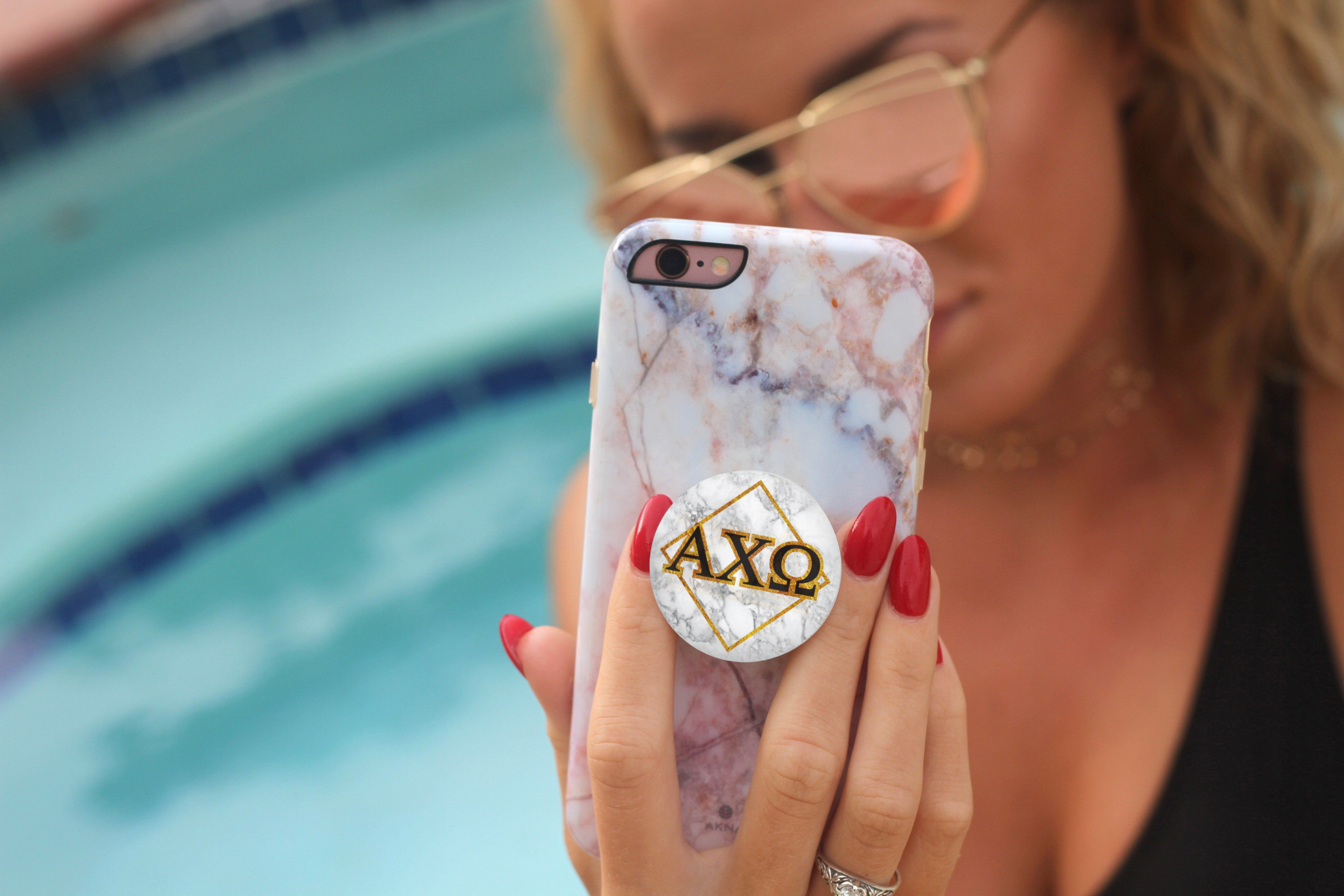 Never drop your phone take better selfies and prop your phone with new alpha chi omega popsockets an official popsockets sorority shop collab