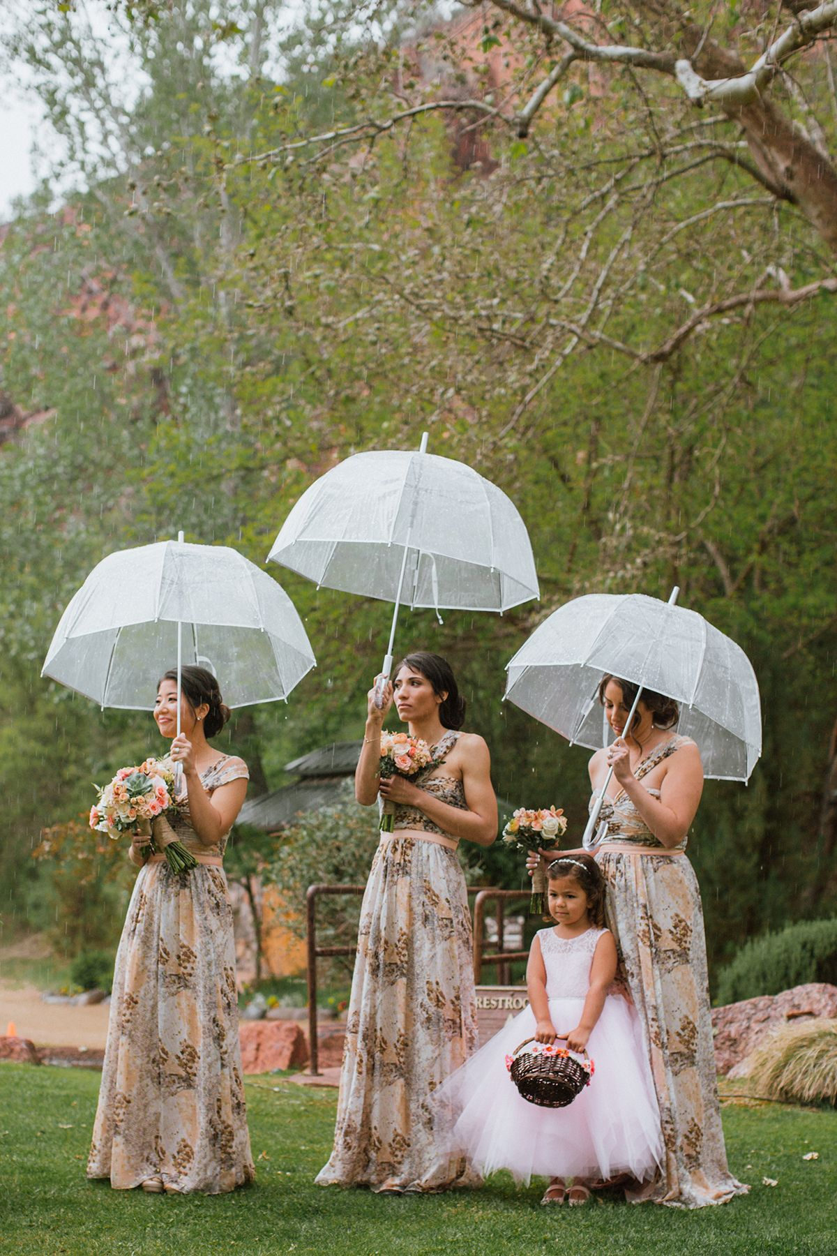 cute clear umbrellas make a fun statement on your rainy wedding day