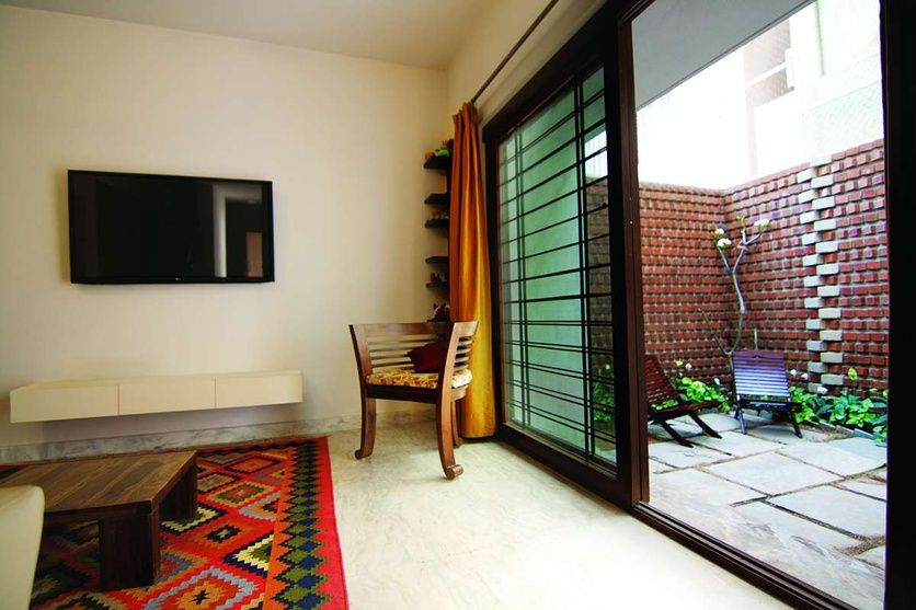 Living area with carpet by kamat rozario architecture for Architecture design for home in mysore