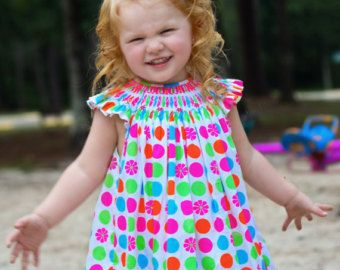Girls Heirloom dress with pink hand smocking and by CarouselWear