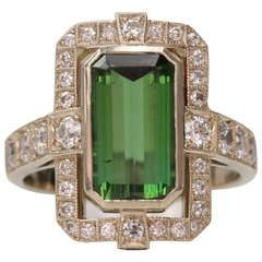 Green Tourmaline Buckle Ring | From a unique collection of vintage cocktail rings at https://www.1stdibs.com/jewelry/rings/cocktail-rings/