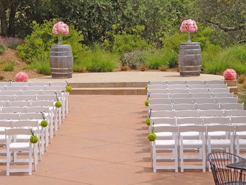 Ceremony Arrangements @ Paradise Ridge Wedding  Pink peonies, pink roses, pink and green hydrangea and green button mums. Flowers and photo by The Wild Orchid floral design in Sebastopol.