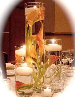 set of 4 cylinder glass vases with calla lilies and floating candles