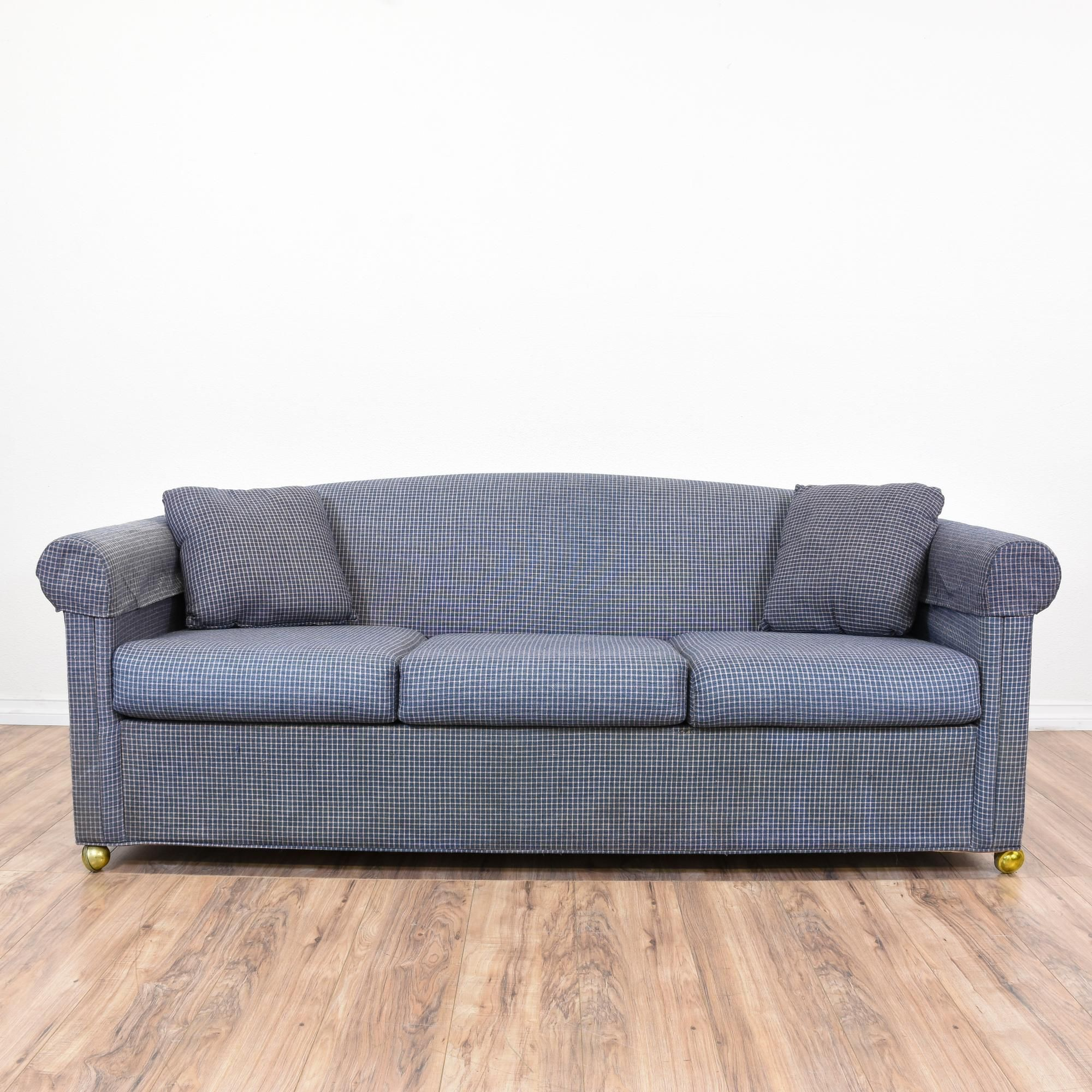 this contemporary sleeper sofa is upholstered in a dark navy blue with a white grid print this. Black Bedroom Furniture Sets. Home Design Ideas