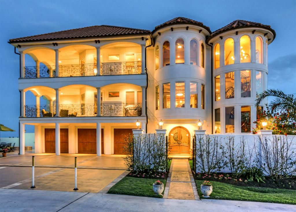 THREE STORY FLOATING SPIRAL STAIRCASE is encased in a windowed turret! Description from txhomeshoprealty.com. I searched for this on bing.com/images