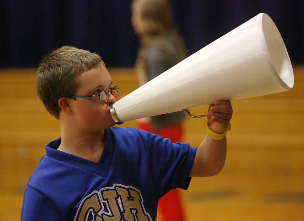 Centerville Junior High Cheerleader Caleb Monson Cheers With Other Members Of The Squad During A Volleyball Game At Cheer Camp Cheer Squad Cheerleading Team