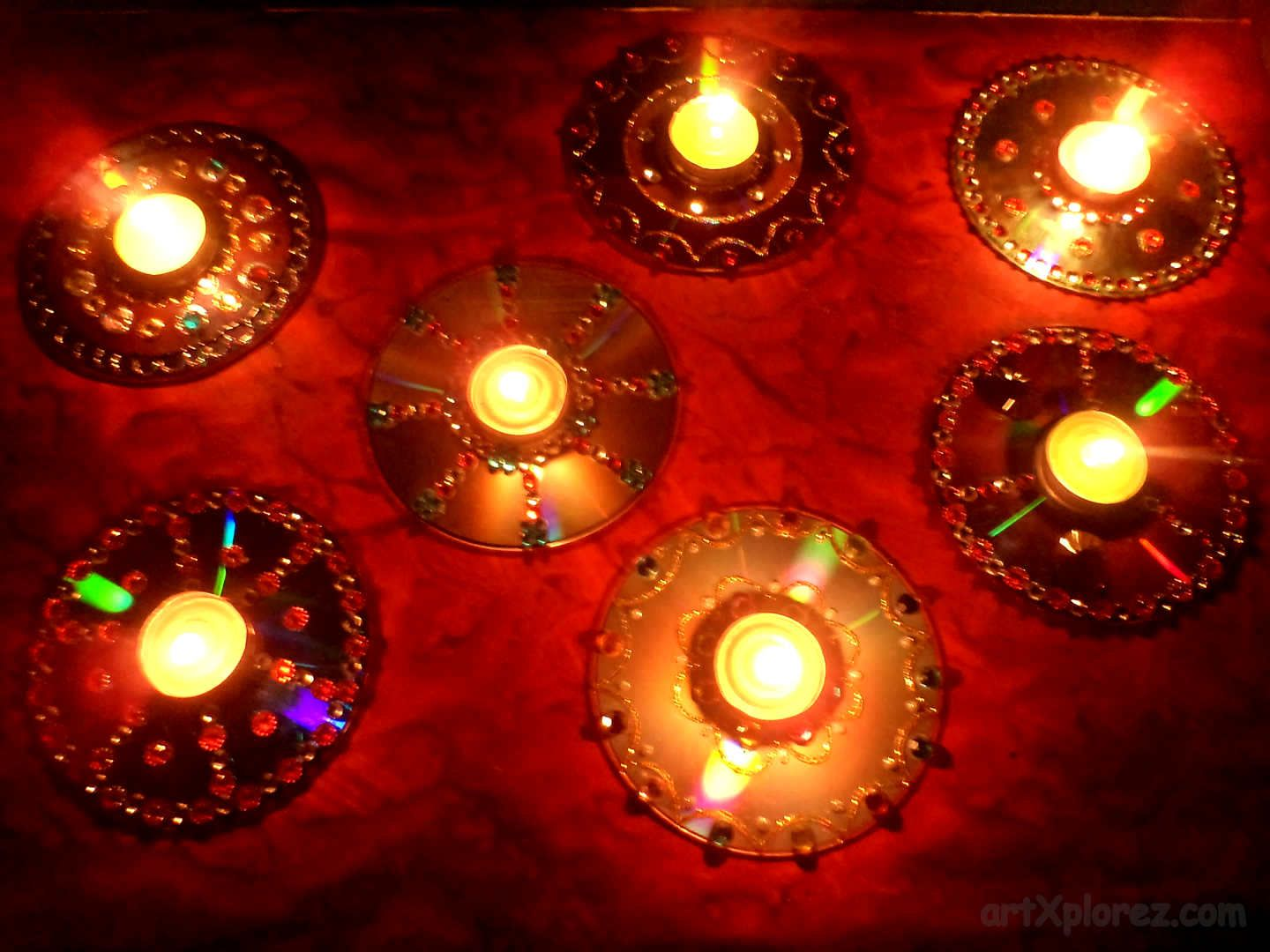 Decorative diyas oil wax lamps using waste cd 39 s for Candle decoration with waste material