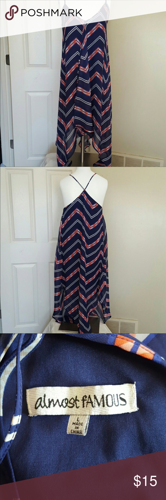 """Super cute summer dress! Size L Handkerchief dress; so cute! Flattering front hides """"problem"""" areas, and colors are beautiful. High-low bottom. Great condition. No stains/tears. Pet/smoke free home. Almost Famous Dresses"""
