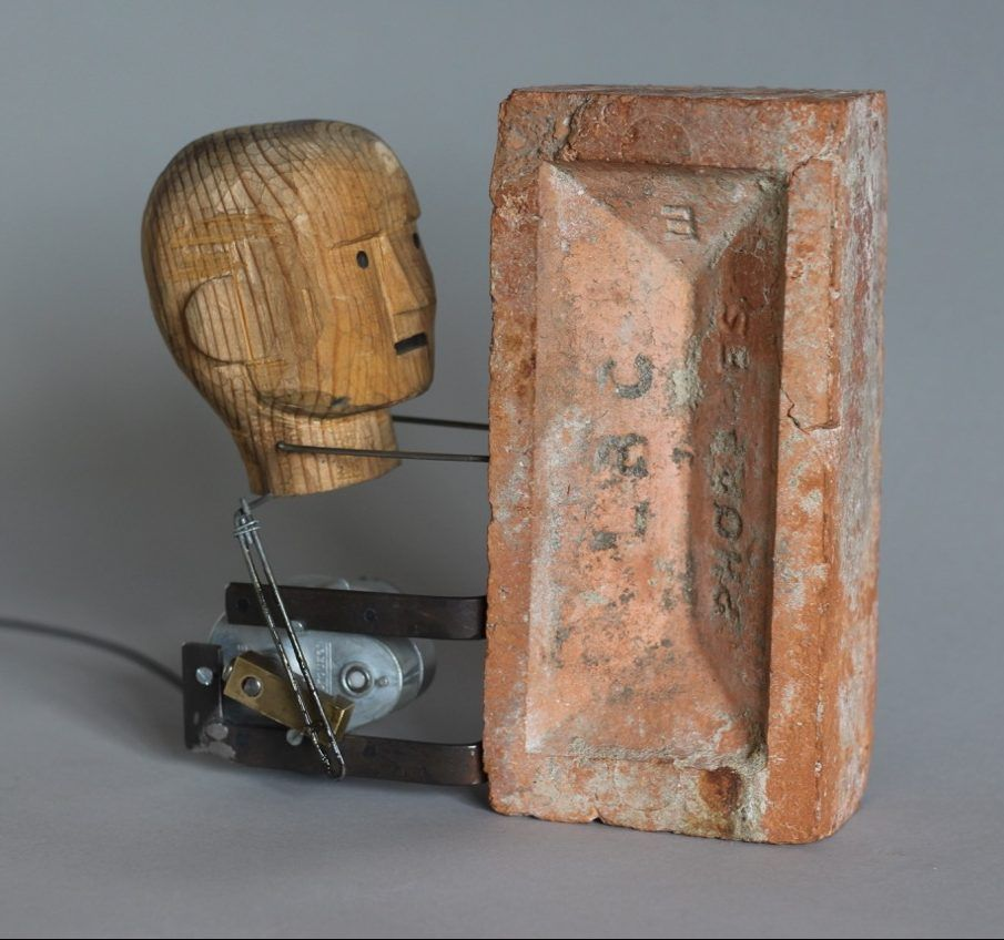 Brick by Nik Ramage. A motorised wooden head bangs itself against a brick. | Brick, Nik, Head banging