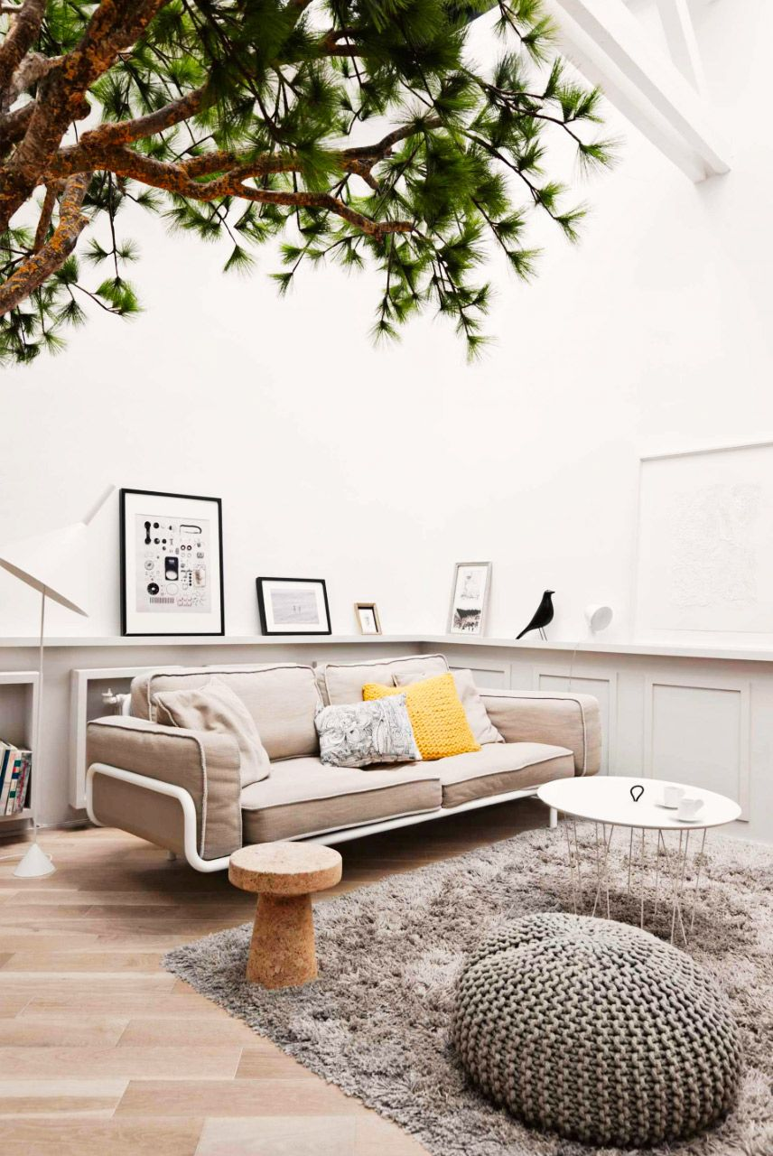 Treehouse-inspired living room with earthy, neutral colors