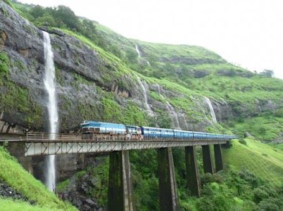 Wonderful (Maharashtra , INDIA)    About the Image: Kurla Express emerges out of Tunnel No. 42 on to a viaduct on UP line. The Zenith waterfalls formed due to rainwater collected on the Behran plateau forms a nice backdrop. http://goo.gl/MnQpi