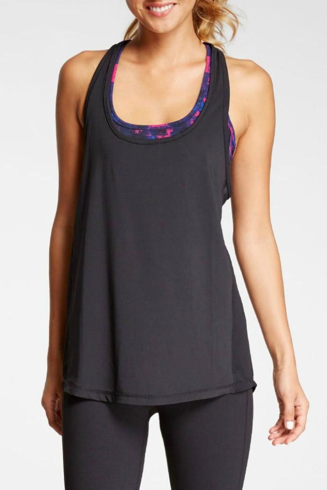Lightweight and supportive bra-tank combo. Relaxed fit tank made of moisture-wicking performance jersey and performance mesh side panels for added breathability. Racerback sports bra provides built-in support.   Kari Workout Tank by Threads 4 Thought. Clothing - Activewear New Jersey
