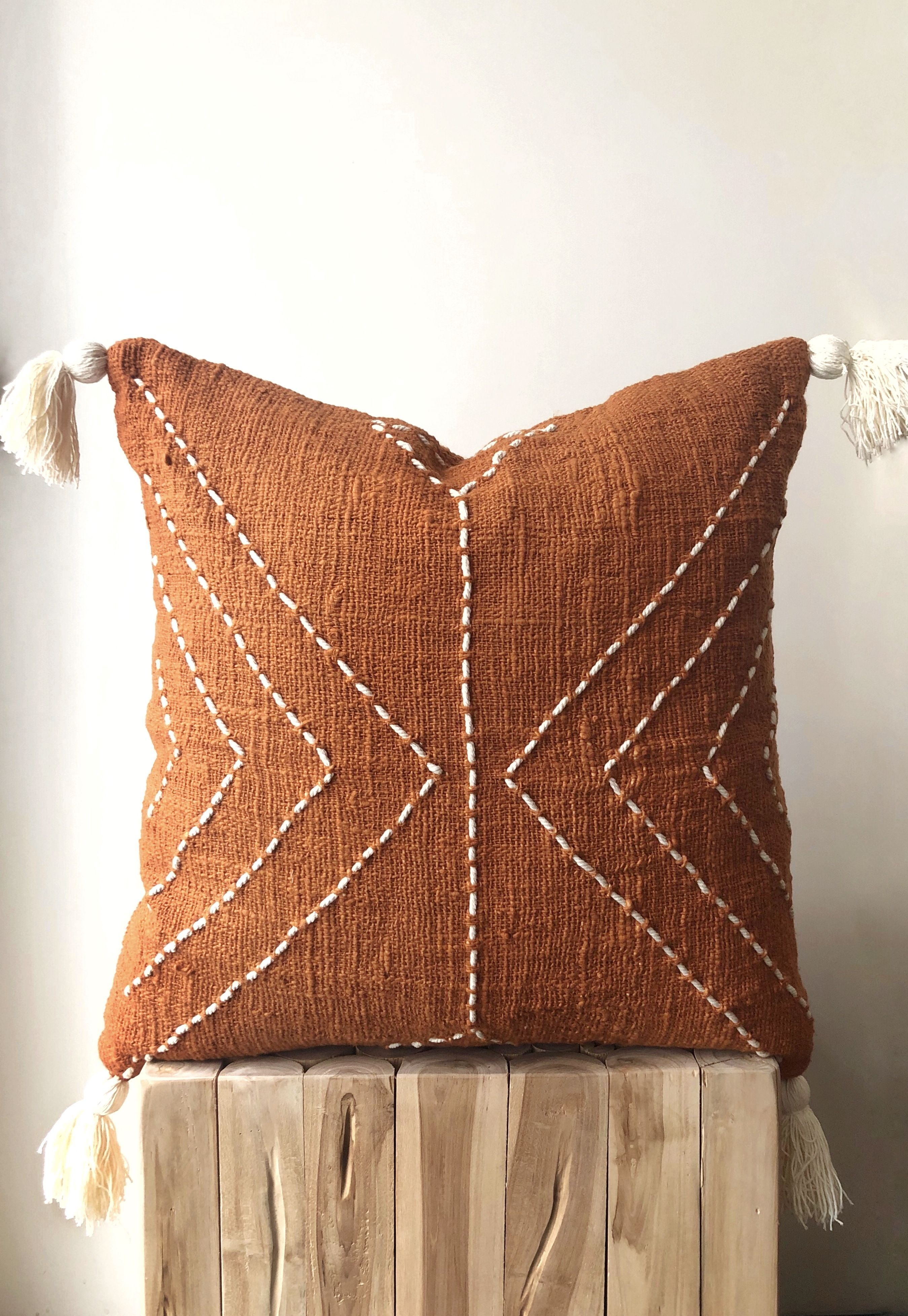 """Burnt Orange Pillow with Tassels. Organic Natural Raw Cotton. Hand-dyed rust colour with stitch finish. 50x50 (20"""") Australia cushions"""