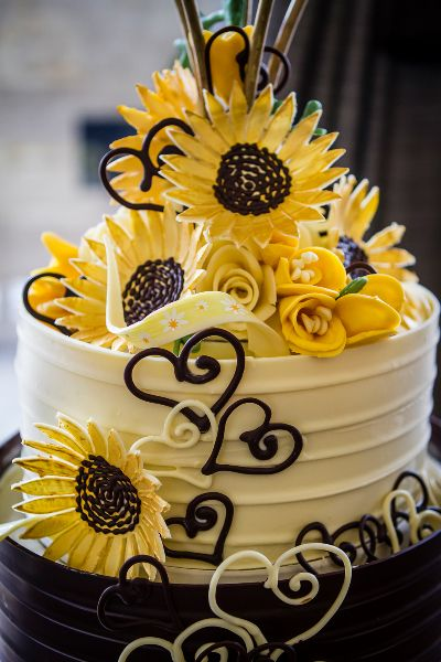 Chocolate Sunflowers on this five tier cale Cakes and sweets