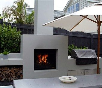 Modern Outdoor Patio Kitchen Idea With Built In Fireplace