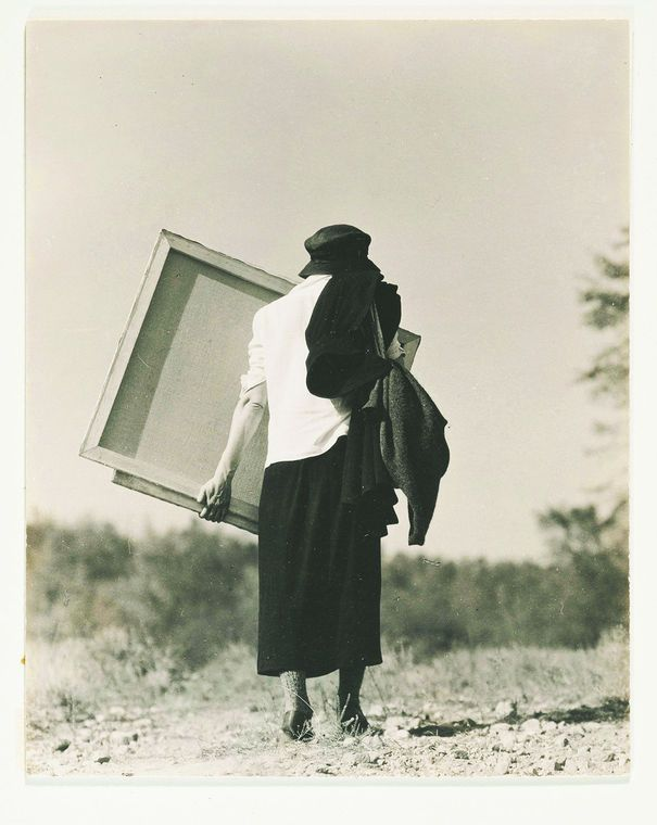 New photo acquisitions at O'Keeffe Museum -- Alfred Stieglitz (1864-1946): Georgia O'Keeffe [Carrying a canvas], 1920s, gelatin silver print flush-mounted on card; courtesy the Georgia O'Keeffe Museum