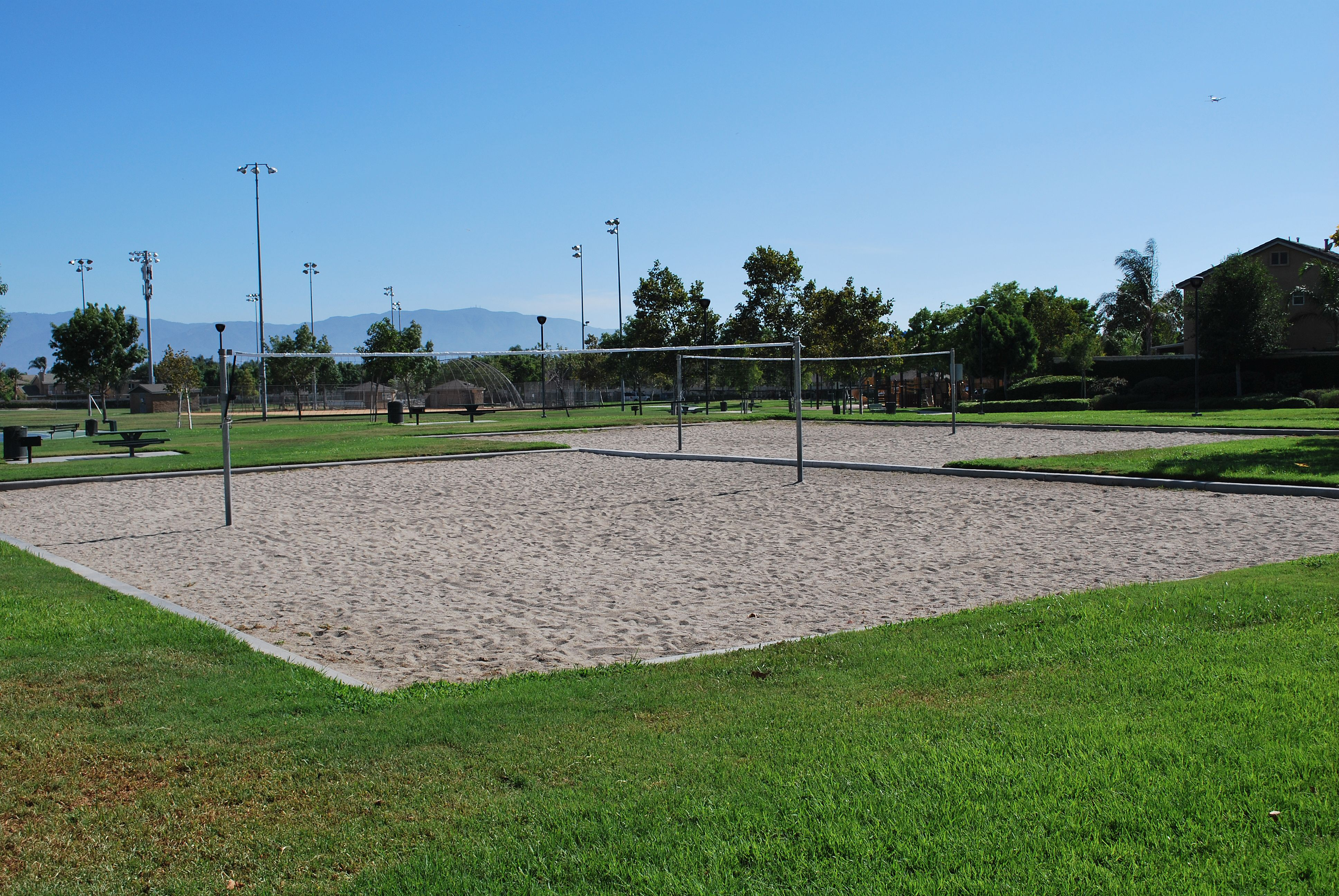 The Two Beach Volleyball Courts At Orchard Park In Eastvale California Playvolleyball Http Youreastvalerealtor Co Orchard Park Beach Volleyball Court Park