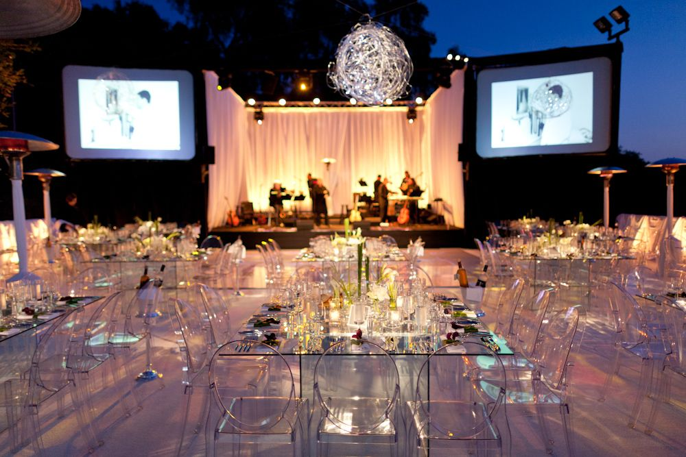 modern glass tables   ghost chairs         wedding  party  flowers