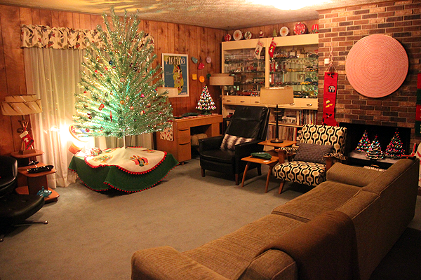 mid century modern  wood paneled  family room decorated for christmas  looks so cozy and
