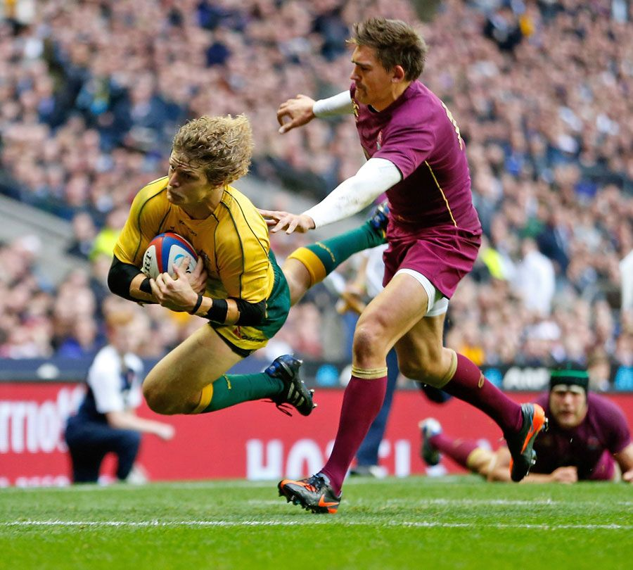Australia's Nick Cummins dives over to score a try Rugby