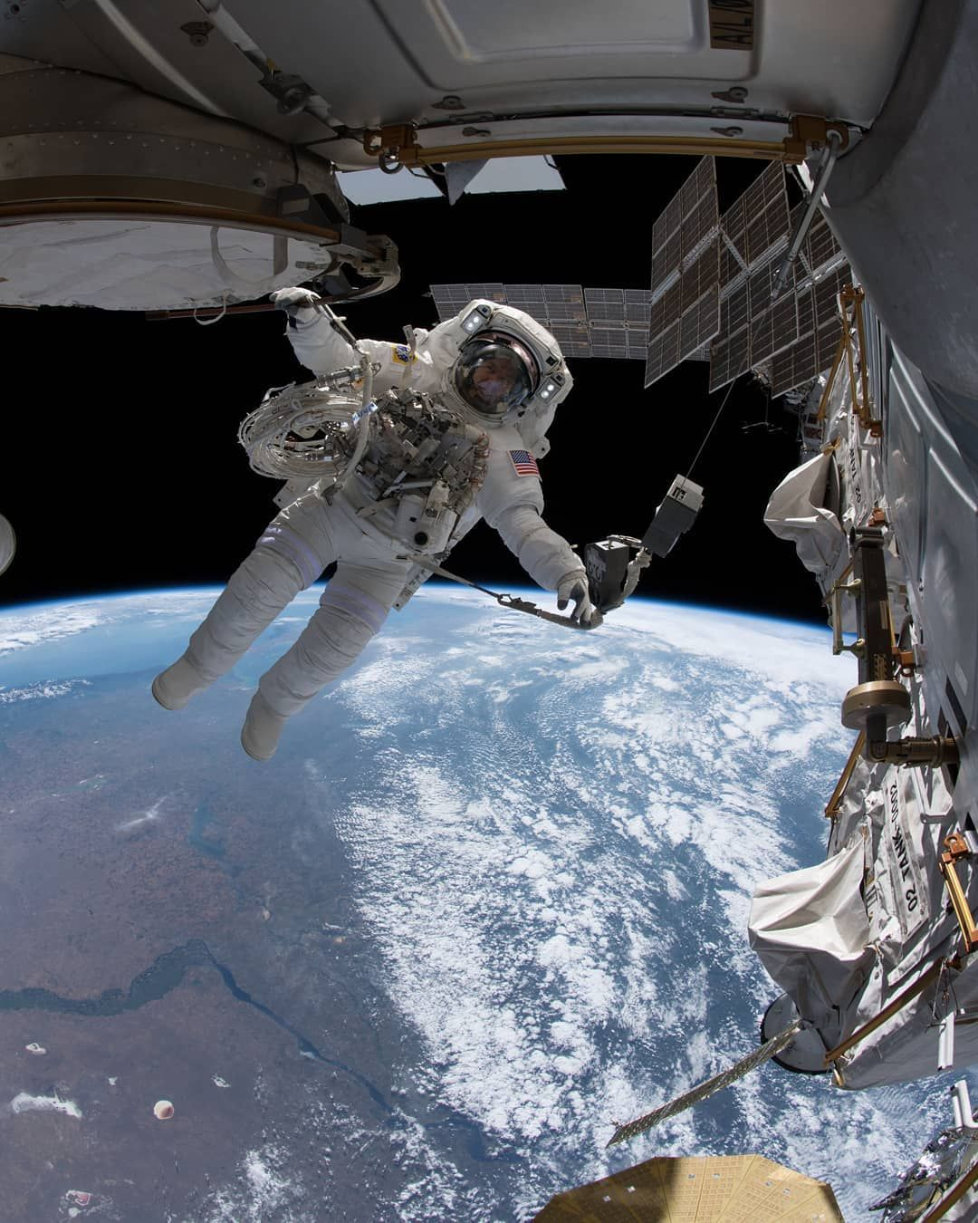 Nasa Astronaut Drew Feustel Is Pictured Tethered To The