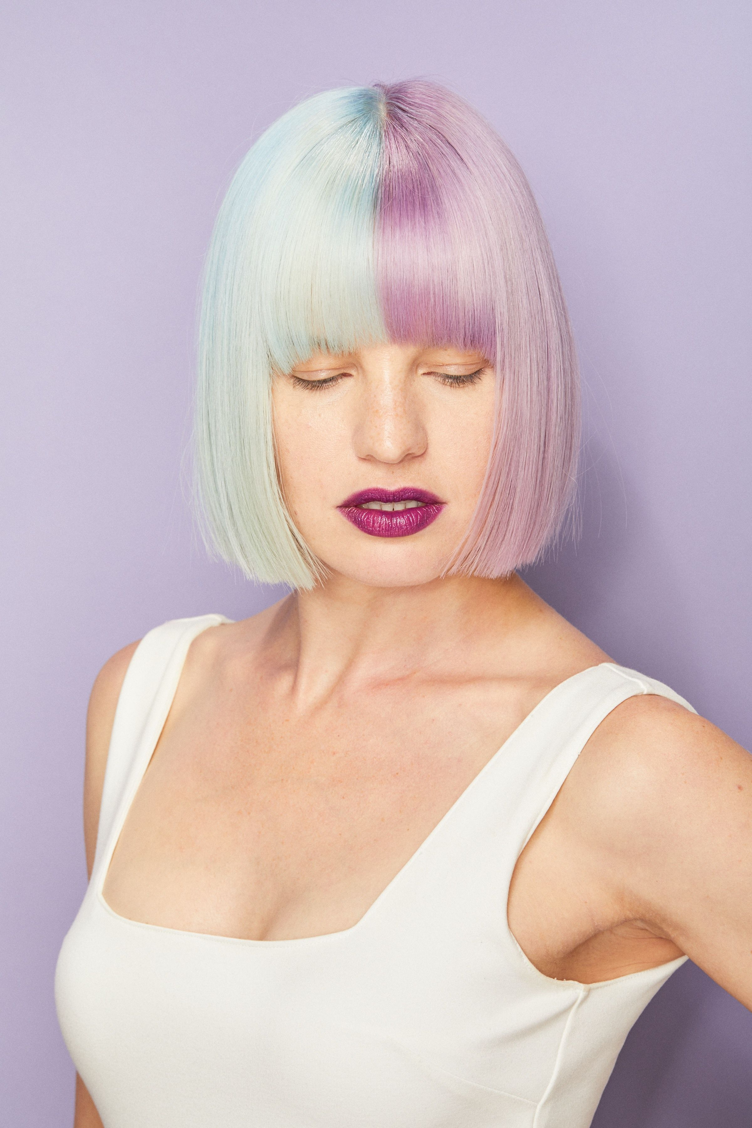 Two tone pastel aveda hair color with pastel blue and lilac shades
