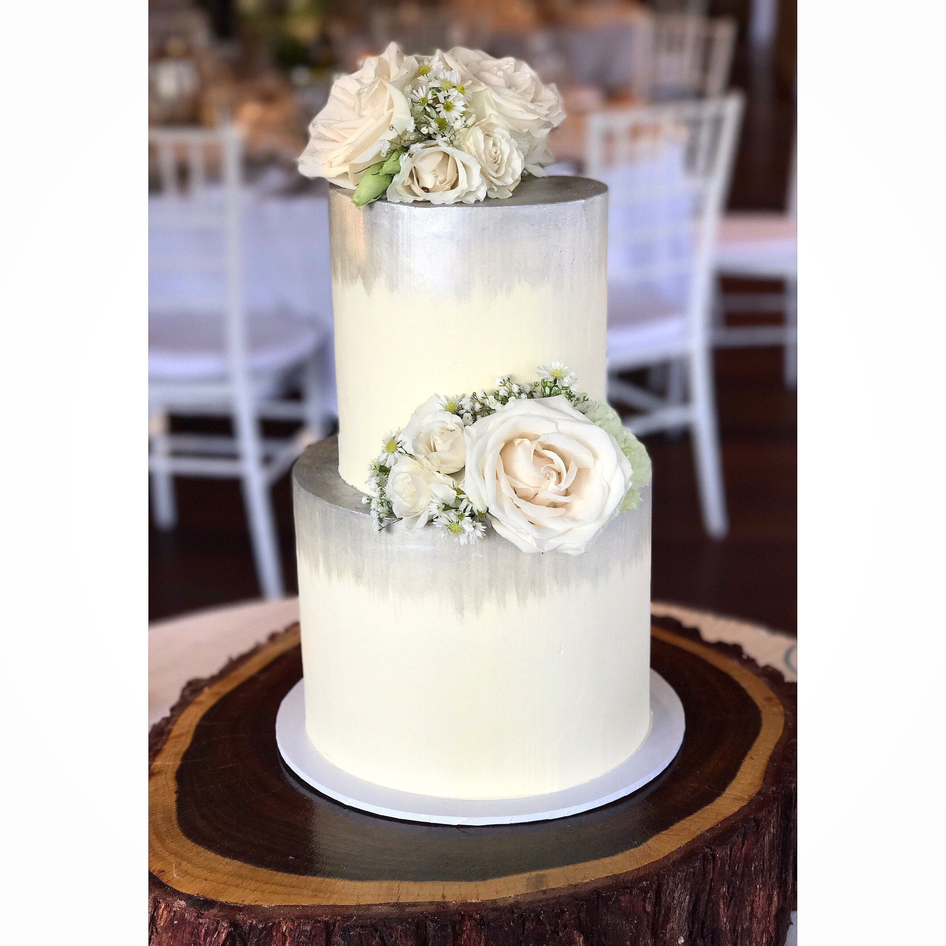 Two tier wedding cake silver detail and fresh blooms wedding cake