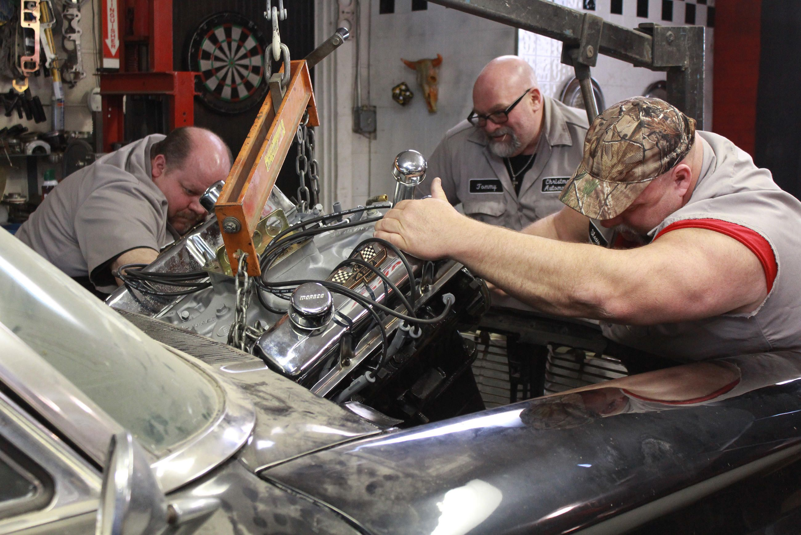 Chuck Kountz, Tommy Christmas, and Steve McGranahan installing a ...