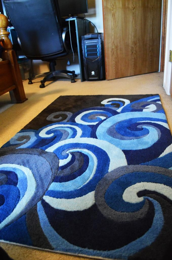 I love this gorgeous rug that is perfect in everything from a kids room, modern/eclectic master bedroom, or nautical themed office!