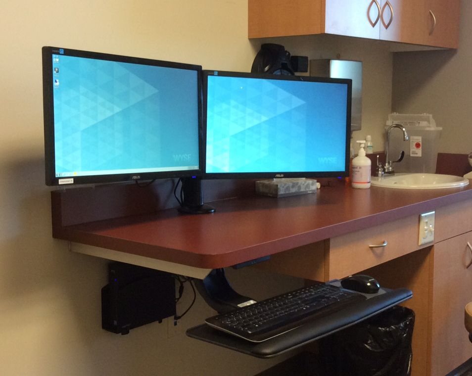 An Ergonomic Doctor S Office Setup Including A Dual
