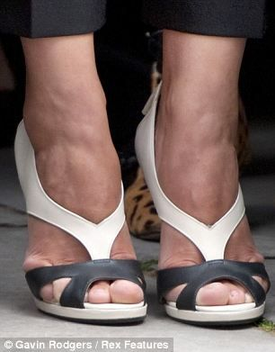 Kim Kardashian's swollen feet crammed into plastic shoes, Julianne Moore's  toes crippled by sandals... FEMAIL reveal the worst celebrity foot faux pas