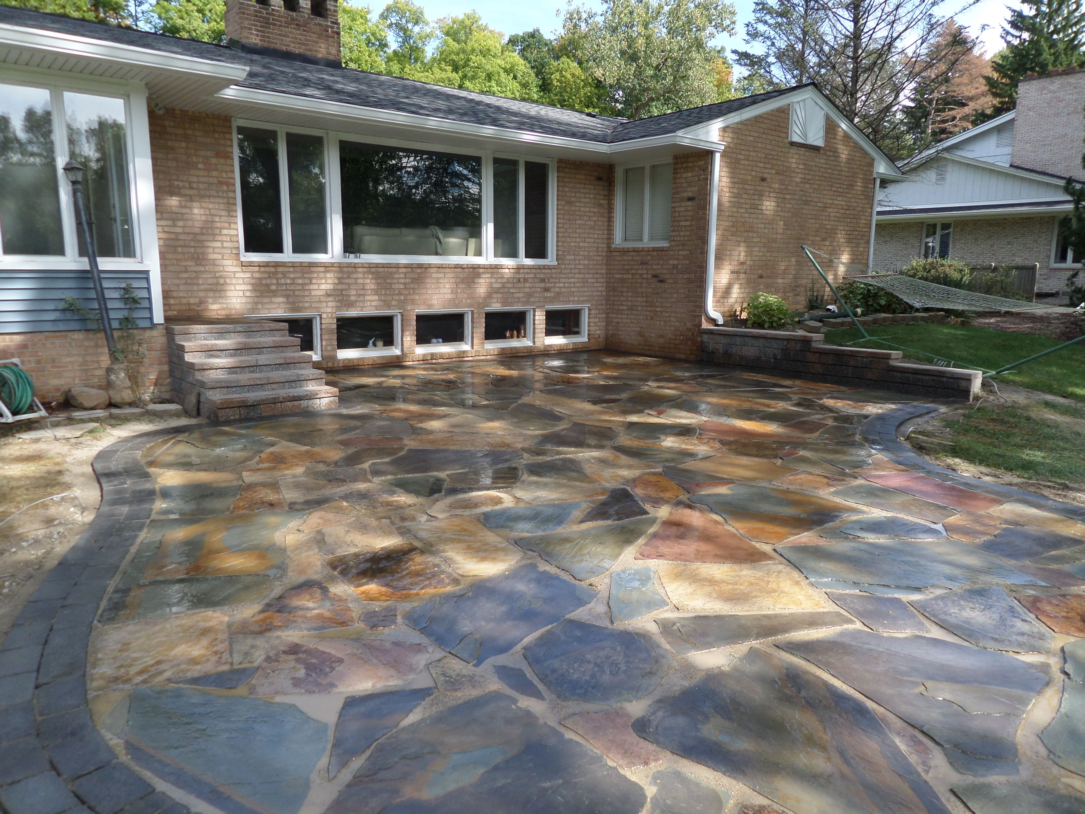 Natural stone patio new york flagstone with a oaks for Blue stone paver patio