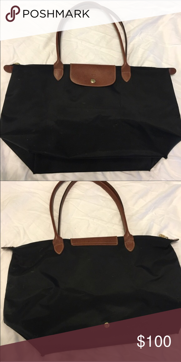 Longchamp Le Pliage Large Tote Bag Authentic. Leather straps. Has signs of  wear (light stains and small hole) but in good shape. Longchamp Bags Totes 6c6e13dc99