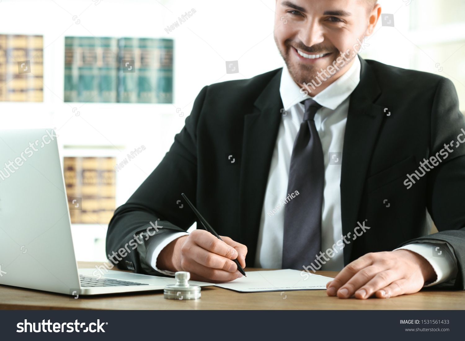 Male notary working with documents at table royalty free