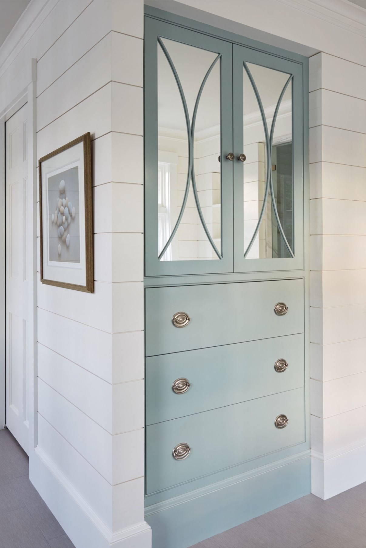 Furniture Detailing On This Blue Linen Cabinet Lends Elegance To