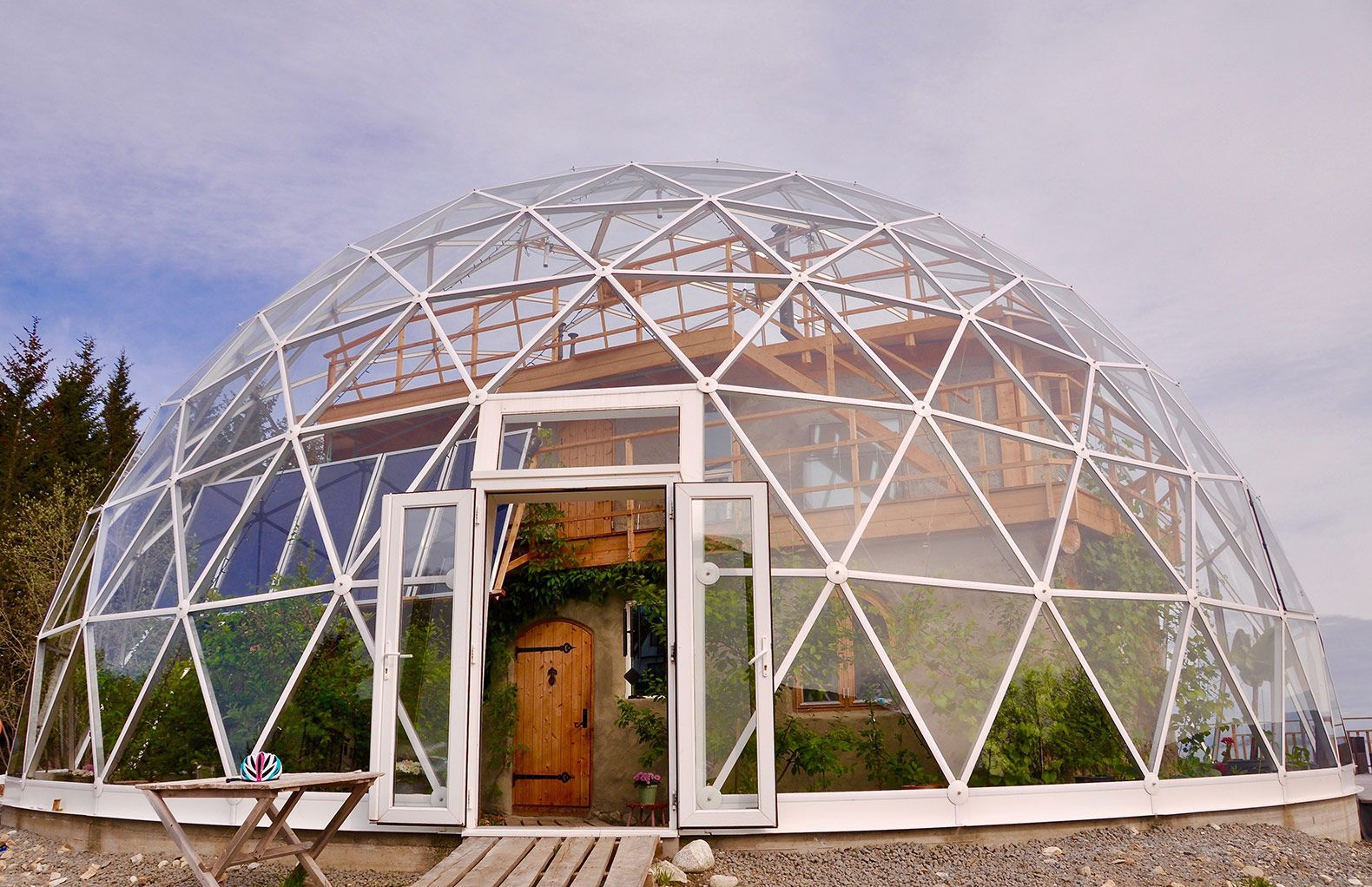Nature House by Benjamin and Ingrid Hjertefølger is a solar geodesic dome, a corn cob house, on Sandhornoya Island of northern Norway.