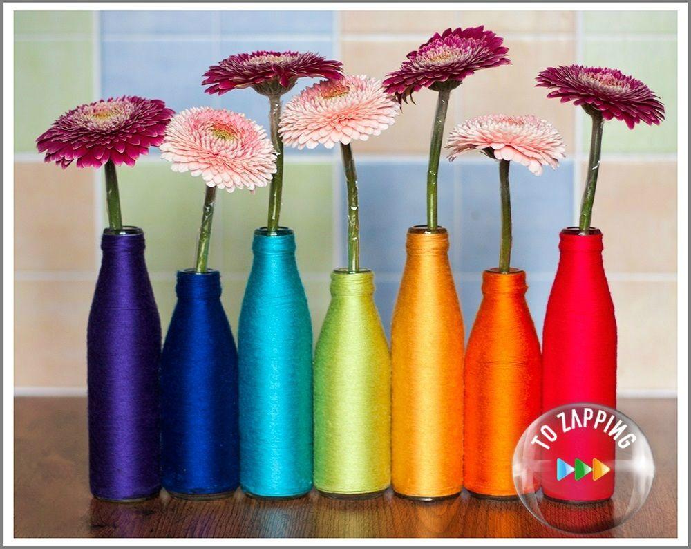 Floreros reciclados con botellas y lana de colores - Manualidades en lana ...