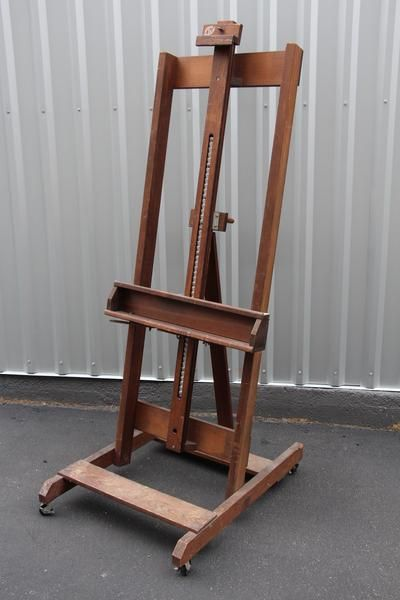 this warm antique easel on wheels beautifully displays anything placed on it whether displaying fine