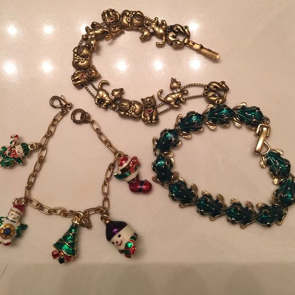 Bracelet Bundle! These bracelets have been sitting in my jewelry box for years. The frog & cat one are in pretty good condition. I don't see any tarnishing on those. However the Christmas one has a slight tarnish on clasp. Variety Jewelry Bracelets