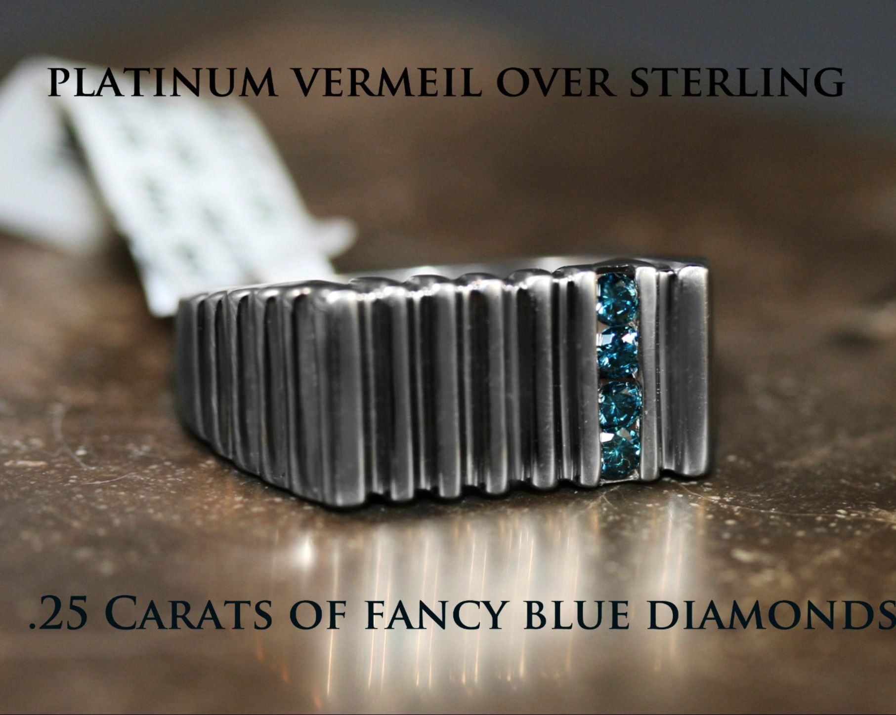 Brand New Platinum Plated Sterling Silver Mens Ring, with Tension-Set Round Faceted Blue Diamond. Full Under-Gallery.