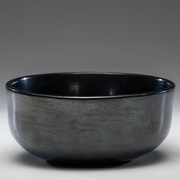 Maria Martinez (San Ildefonso, 1887-1980) Blackware Bowl formed with clean lines and a deep bowl; highly burnished with light gunmetal surface; signed on base Marie, height 4 in. x diameter 8.5 in. ca 1930