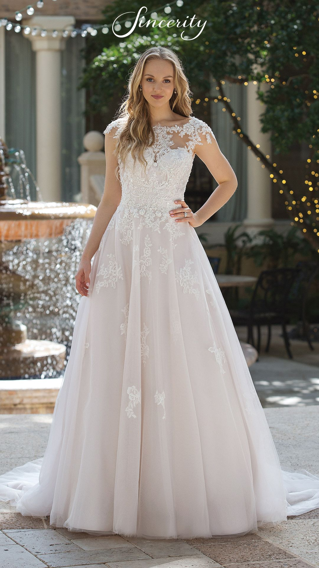 0451cc39d44 Feel like a princess on your wedding day in this princess ball gown (Style  44101). This look features a beaded lace illusion bodice with cap sleeves