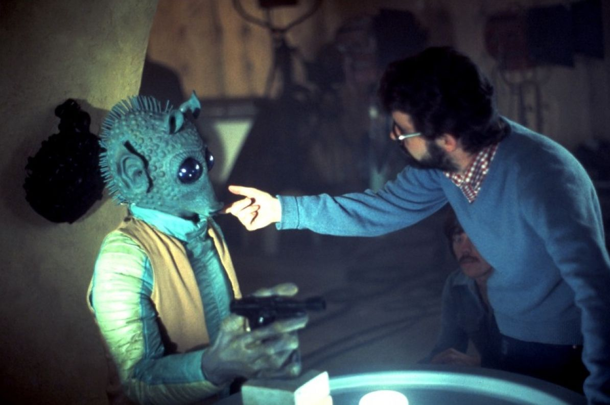 Director George Lucas reminds Greedo to shoot first on the cantina set of the original Star Wars (1977)