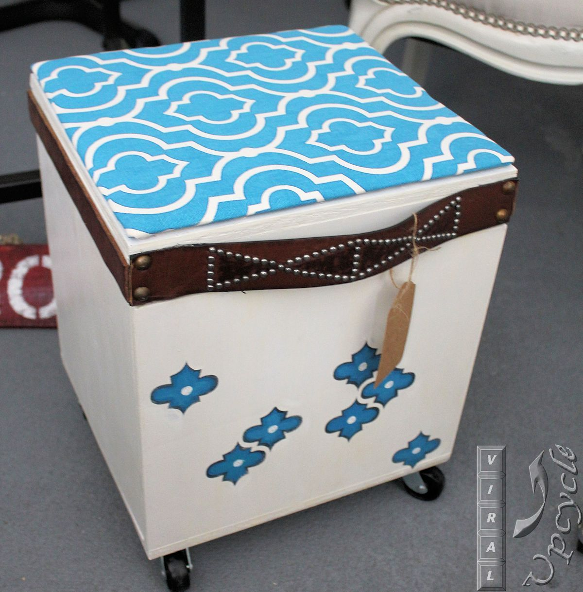 Boring storage to fun upcycled trunk.  Use thrift store belts and fabric wrapped cardboard for a faux cushion ~ Viral Upcycle