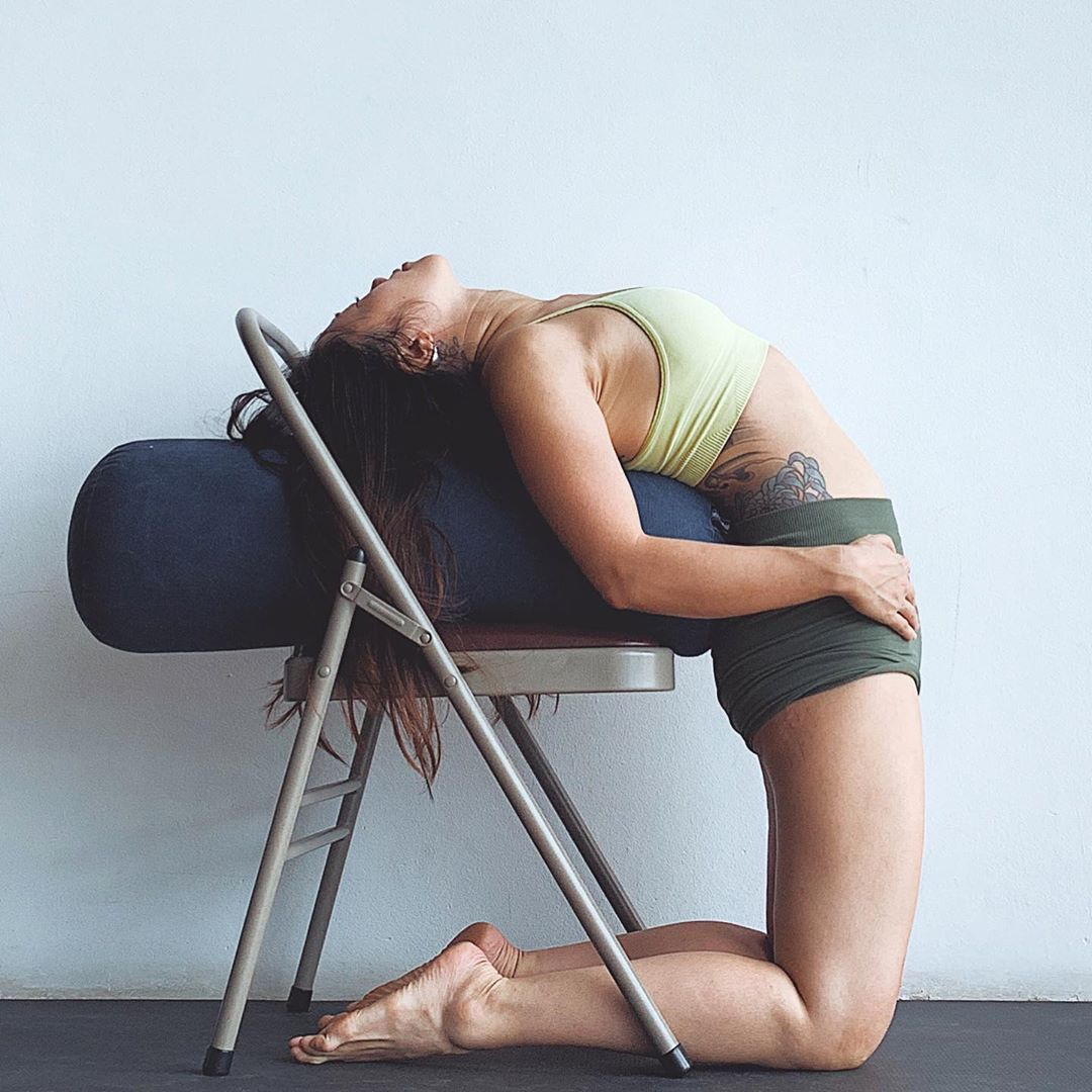 Backbends Can Be Stressful To Do But This Set Up Makes It Feel Almost Relaxing Sometimes Approaching Things That Ar In 2020 Ayurveda Yoga Iyengar Yoga Chair Pose Yoga